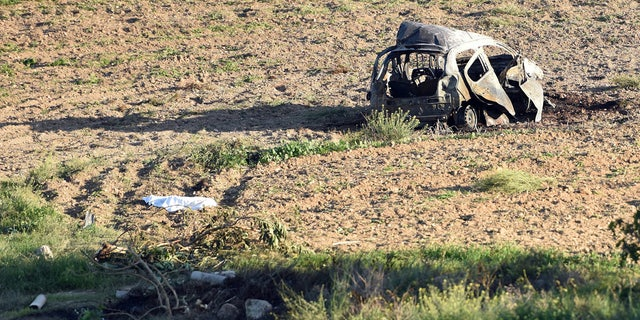 Journalist Daphne Caruana Galizia's bombed out car is seen in this file photo.