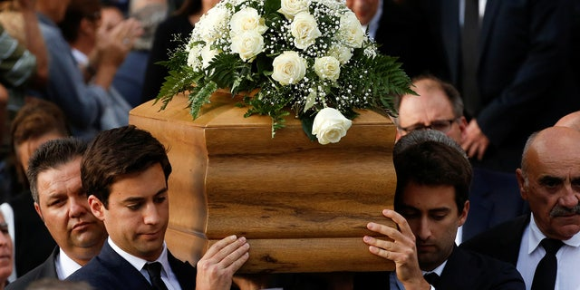 Journalist Daphne Caruana Galizia's sons Matthew and Paul carry the coffin of their mother, who was murdered in a car bomb attack, leaving Rotunda Parish Church in Mosta, Malta, Nov. 3, 2017.