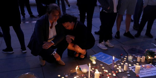 People pay their respects to the 22 people killed at the Manchester Arena bombing.
