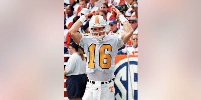 University of Tennessee quarterback Peyton Manning raises his arms, taunting the crowd in partisan Florida Field prior to action September 20 against the University of Florida. The hotly contested Southeastern contest was played before a sellout crowd.  SPORT FOOTBALL - RP1DRIDSKOAB