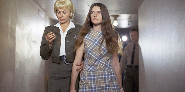 FILE - In this Feb. 24, 1970 file photo, Patricia Krenwinkel, a defendant in the Tate murder case, enters the superior court in Los Angeles for an arraignment.