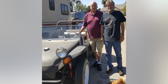 Don Martin (R) inherited the buggy from his stepfather, who bought it from Don Graves (L).