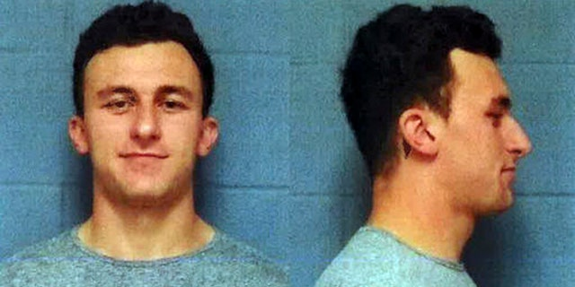 This booking photo provided by the Highland Park, Texas, Department of Public Safety, shows former Cleveland Browns quarterback Johnny Manziel, who was booked and posted bond Wednesday, May 4, 2016, in a domestic violence case, one day before he faces his first court hearing. The Heisman Trophy winner and former Texas A&M star was indicted by a grand jury last month after his ex-girlfriend alleged he hit her and threatened to kill her during a night out in January.  (AP Photo/Highland Park Department of Public Safety)