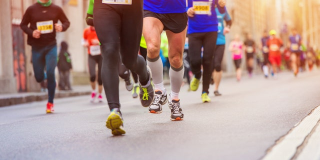Unrecognizable young runners at the city race