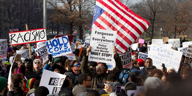 Dec. 13, 2014: Demonstrators chant at Freedom Plaza in Washington, Saturday during the Justice for All rally and march. (AP)
