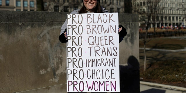 A demonstrator poses for a photo during the Women's March in Chicago on Jan. 20, 2018.