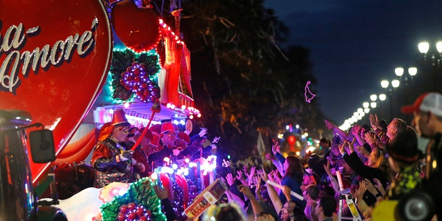 Float riders tossing beads during the Krewe of Bacchus Mardi Gras parade in New Orleans, in February.