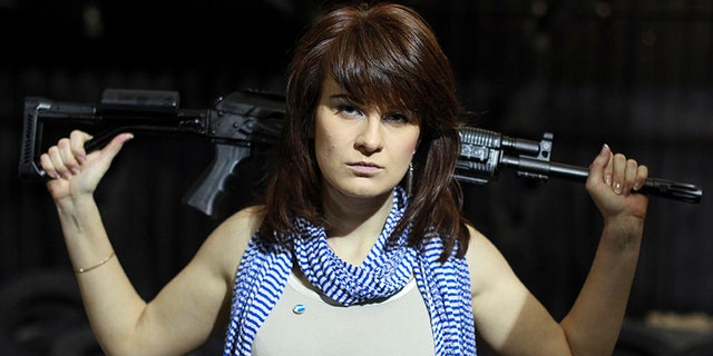Maria Butina, a gun-rights activist, poses for a photo at a shooting range in Moscow, Russia.