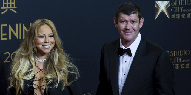 October 27, 2015. Singer Mariah Carey (L) and Australian billionaire James Packer, co-chairman of Melco Crown Entertainment, pose on the red carpet before the opening ceremony of Studio City in Macau, China.