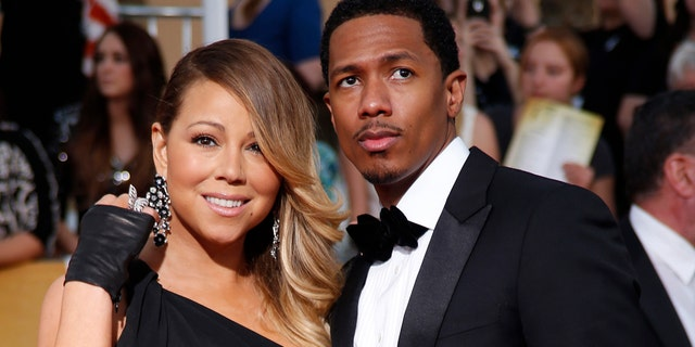Mariah Carey and husband, Nick Cannon, arrive at the 20th annual Screen Actors Guild Awards in Los Angeles, California January 18, 2014.