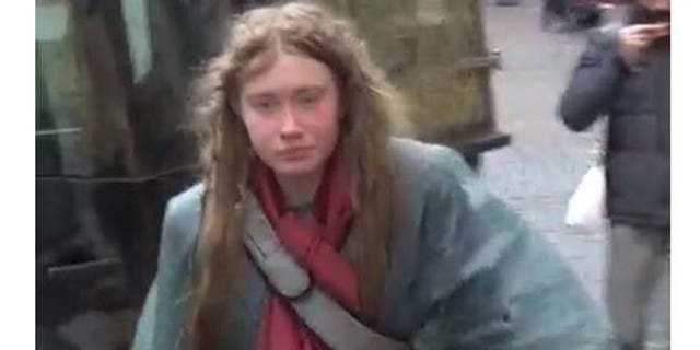 The unidentified woman is seen walking through the streets of Rome.