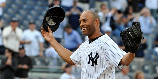 New York Yankees closer Mariano Rivera acknowledges the cheers of the crowd after recording his 602nd career save, after the Yankees beat the Minnesota Twins 6-4 at Yankee Stadium in New York, on Sept, 19, 2011.