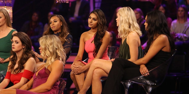 """Former """"Bachelor"""" contestant Marikh Mathias (center) accused another contestant of """"glam-shaming"""" her, after she was called out for fixing her hair during a hiking segment."""