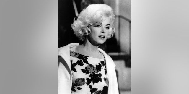 """Monroe, seen here in an April 1962 file photo on the set of her last movie, """"Something's Got To Give,"""" reportedly had a lengthy process for glowing skin."""