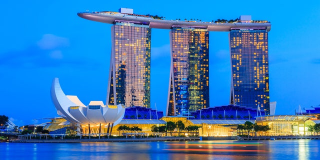 The Marina Bay Sands Resort is seen at twilight.