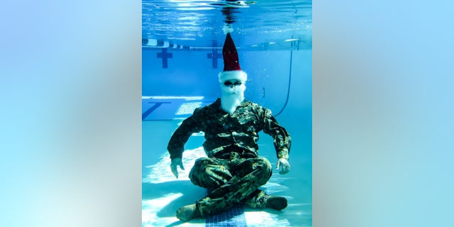 The Honorable Mr. Santa Claus, Commanding Officer of Holiday Cheer, NORTHPOLECOM, conducts basic swim qualification at Camp Pendleton, Calif., Dec. 19, 2017. Basic water survival is a training requirement for Claus and all operational reindeer to pass every two years to maintain their water survival skills. The purposes of this training was to ensure the NORTHPOLECOM Logistics team was prepared for their upcoming night operations on Christmas Eve.