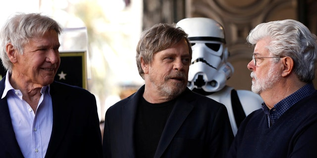Harrison Ford, Mark Hamill and George Lucas stand together at Hamill's star ceremony.