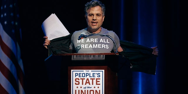 "Mark Ruffalo shows his T-shirt reading ""We are all dreamers"" during the ""People's State of the Union"" event at The Town Hall in New York, Monday, Jan. 29, 2018."