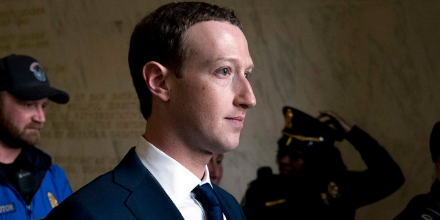 In this April 11, 2018, file photo, Facebook CEO Mark Zuckerberg departs after testifying before a House Energy and Commerce hearing on Capitol Hill in Washington about the use of Facebook data to target American voters in the 2016 election and data privacy.