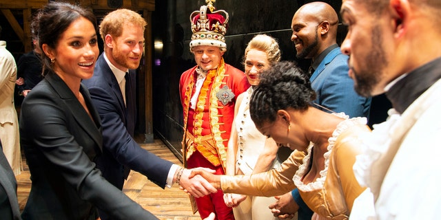 Britain's Prince Harry and Meghan, Duchess of Sussex meet the cast after a gala performance of the musical Hamilton, in support of the charity Sentebale, at the Victoria Palace Theatre in London, Wednesday, Aug. 29 2018. The evening will raise awareness and funds for Sentebale's work with children and young people affected by HIV in southern Africa. (Dan Charity/Pool Photo via AP)