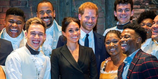 Britain's Prince Harry and Meghan, Duchess of Sussex meet the cast after a gala performance of the musical Hamilton, in support of the charity Sentebale, at the Victoria Palace Theatre in London, Wednesday, Aug. 29 2018.