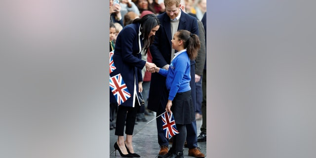 Markle meets student, Sophia Richards in Birmingham, England.