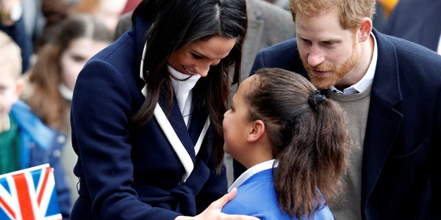 Markle and Prince Harry greet fans in Birmingham, England, on International Women's Day.