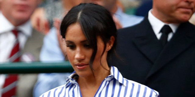 Markle was snapped toting her hat while entering the royal box at Wimbledon.