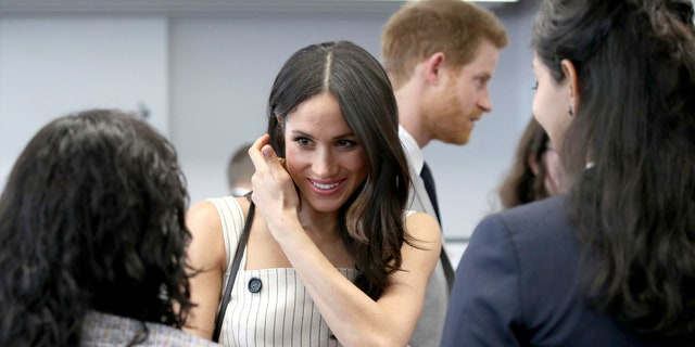 Markle speaks with Commonwealth forum delegates during royal event.