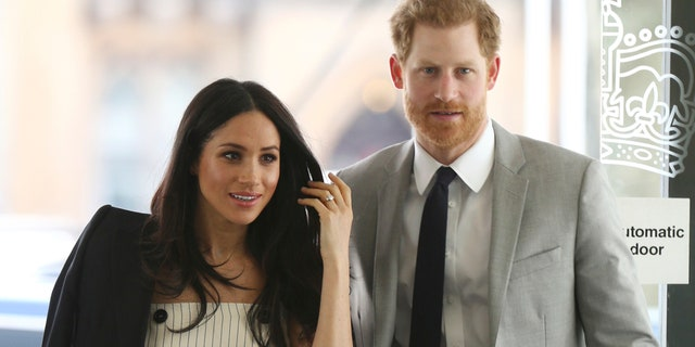 Britain's Prince Harry and Meghan Markle attend a reception for the Commonwealth Youth Forum at the Queen Elizabeth II Conference Centre, London, during the Commonwealth Heads of Government Meeting, Wednesday April 18, 2018. (Yui Mok/Pool via AP)
