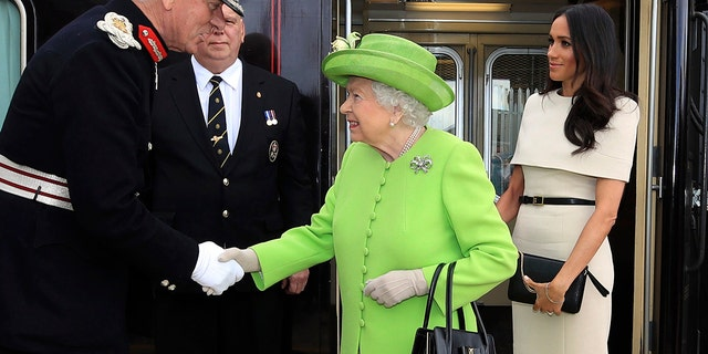 Queen Elizabeth and Meghan, the Duchess of Sussex arrive by Royal Train at Runcorn Station, north west England, Thursday June 14, 2018.
