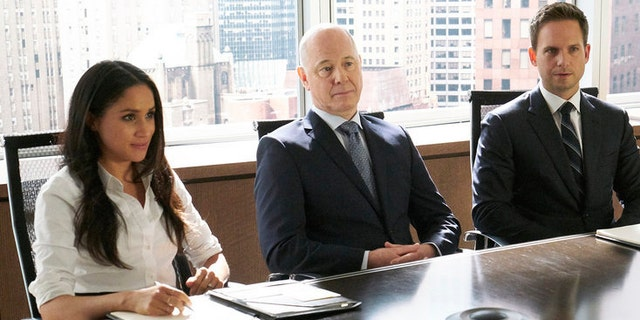 "Pictured: (l-r) Meghan Markle as Rachel Zane, Patrick J. Adams as Mike Ross in an episode of ""Suits."""