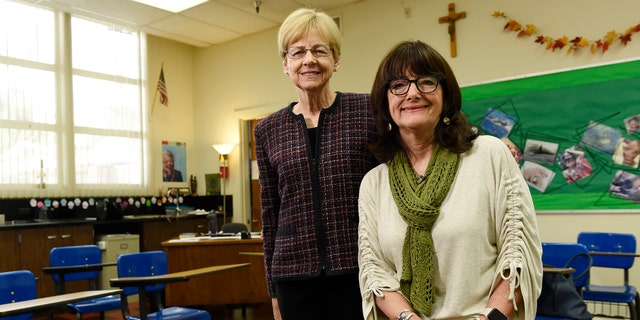 Christine Knudsen, left, theology chair at Immaculate Heart High School, and theology teacher Maria Pollia pose inside a classroom at the school in Los Angeles. Knudsen and Pollia were both teachers of Meghan Markle.