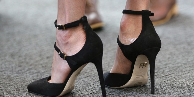 Meghan wears $470 Paramour heels by Tamara Mellon to the Commonwealth Youth Forum last month.