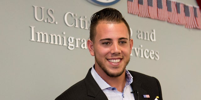Jose Fernandez smiles after becoming a U.S. citizen during a naturalization ceremony in Miami on April 24, 2015.