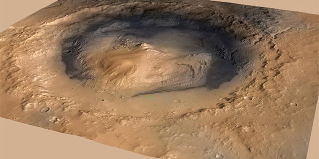 NASA's Curiosity rover landed in the Martian crater known as Gale Crater, which is approximately the size of Connecticut and Rhode Island combined. A green dot shows where the rover landed, well within its targeted landing ellipse, outlined in blue.