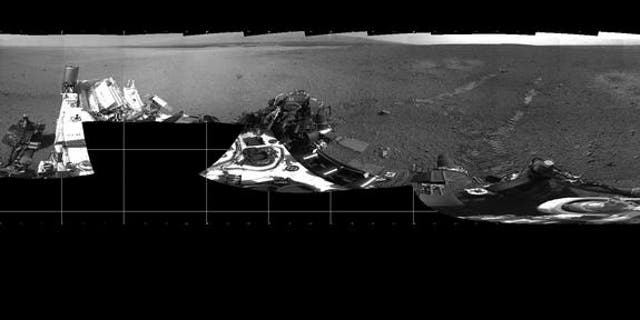 """NASA's Mars rover Curiosity took this panorama on Mars on Aug. 22, 2012, just after its first test drive. The landing site has been named """"Bradbury Landing"""" in honor of the late sci-fi author Ray Bradbury."""
