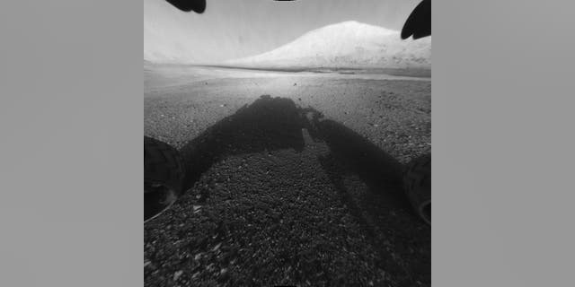 NASA's Mars rover Curiosity snapped this picture of Mount Sharp with its front Hazard Avoidance camera, or Hazcam. The photo was released by NASA on Aug. 6, 2012.