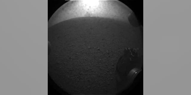 This photo shows one of the six wheels of NASA's huge rover Curiosity on Mars just after the rover's Aug. 5 PDT, 2012 landing in Gale Crater. This image is an enlarged version from the original 256-pixel image.
