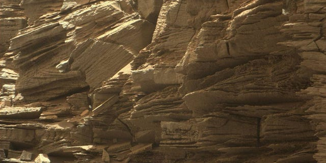 This closeup view from NASA's Curiosity rover shows finely layered rocks on Mars, deposited by wind long ago as migrating sand dunes.