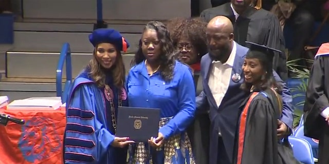 Trayvon Martin's parents, Sybrina Fulton and Tracy Martin, take the stage at Florida Memorial University's commencement to receive a posthumous bachelor's degree in aeronautical science on their son's behalf.