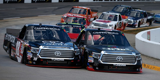 Camping World trucks battle it out on the banks of Martinsville Speedway.