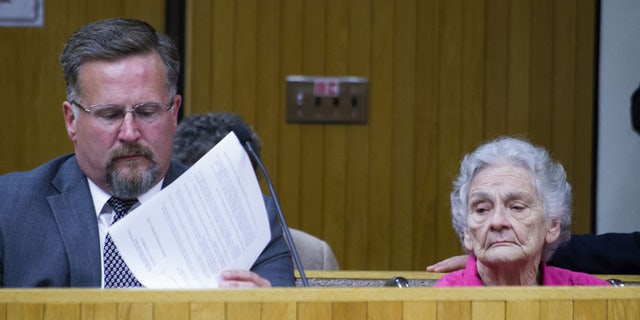 Margaret Kellis with court-appointed attorney last week in Moore County courtroom.