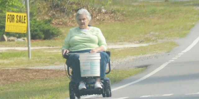 Margaret Kellis operating a motorized wheelchair
