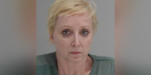 Mary Harrison told cops she fatally shot her husband because he was beating the family cat.