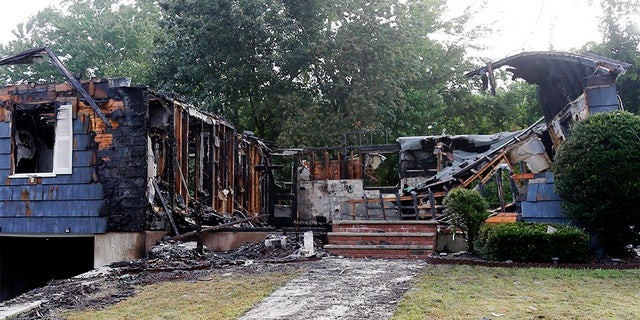 A damaged house in Lawrence, Mass., on Friday morning following gas explosions in the area.