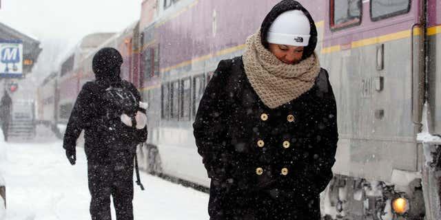 Feb. 9, 2015: Passengers wait at the commuter rail train station.