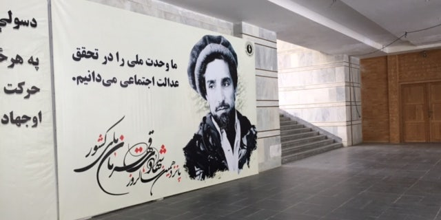 "Wall hanging of the esteemed Ahmad Shah Massoud, the ""Lion of the Panjshir."""