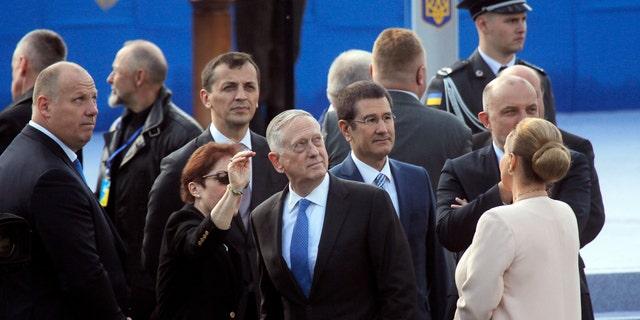 U.S. Defense Secretary Jim Mattis, center, attends a military parade to celebrate independence day in Kiev, Ukraine, Thursday, Aug. 24, 2017