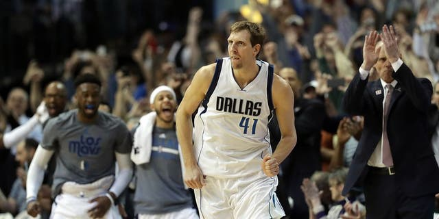 DALLAS, TX - MARCH 07: Dirk Nowitzki #41 of the Dallas Mavericks runs down court after scoring his 30,000 career point in the second quarter against the Los Angeles Lakers at American Airlines Center on March 7, 2017 in Dallas, Texas. NOTE TO USER: User expressly acknowledges and agrees that, by downloading and/or using this photograph, user is consenting to the terms and conditions of the Getty Images License Agreement. (Photo by Ronald Martinez/Getty Images)